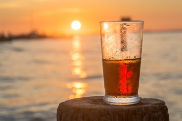 Beer with sunset in background